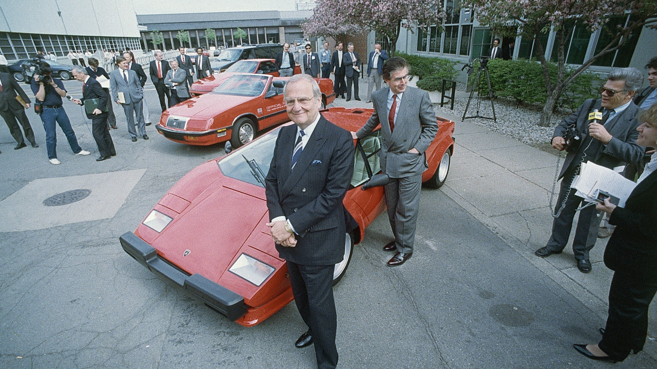 Chrysler Corporation Chairman Lee Iacocca shows off the company's latest acquisition, a Lamorghini Countach, Chrysler bought the Italian car company last week shown, April 27, 1987 in Highland, Michigan. At right is Chrysler Motors Chairman Gerald Greenwald. (AP Photo/Robert Kozloff)