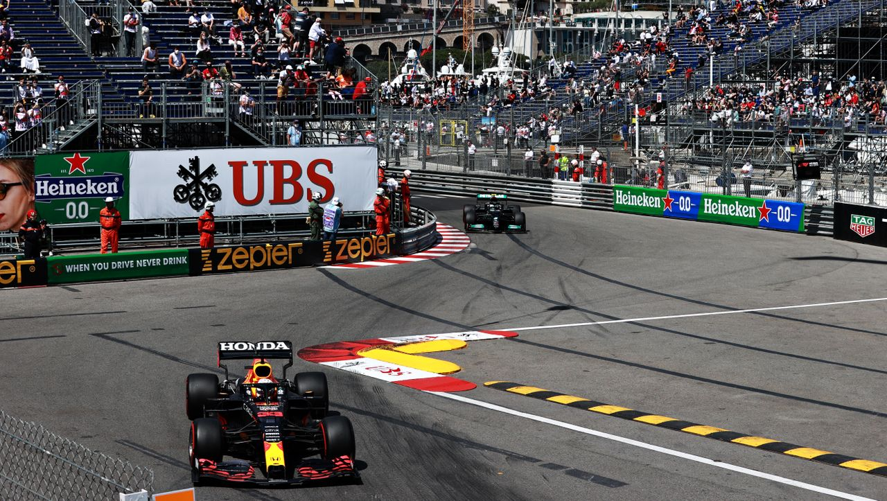 MONTE-CARLO, MONACO - MAY 23: Max Verstappen of the Netherlands driving the (33) Red Bull Racing RB16B Honda leads Valtteri Bottas of Finland driving the (77) Mercedes AMG Petronas F1 Team Mercedes W12 during the F1 Grand Prix of Monaco at Circuit de Monaco on May 23, 2021 in Monte-Carlo, Monaco. (Photo by Mark Thompson/Getty Images)